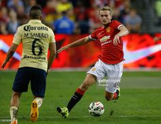 James Wilson #49 of Manchester United dribbles against Miguel Samudio #6 of Club America