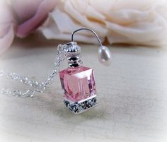 Items similar to Miniature Pink Perfume Bottle Atomizer Swarovski Crystal Freshwater Pearls Sterling Silver Necklace - Eight Additional Color Choices on Etsy Bead Bottle, Bottle Jewelry, Bottle Necklace, Perfume Atomizer, Antique Perfume Bottles, Vintage Perfume, Miniature Bottles, Miniature Crafts, Pink Perfume