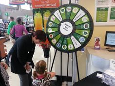 At the grand opening of the new Sobeys on Wyse Road in Dartmouth!! Free cake, coffee and you can spin the wheel for a ton of prizes! Buy this Prize Wheel at http://PrizeWheel.com/products/floor-prize-wheels/floor-table-black-clicker-prize-wheel-18-slot/.