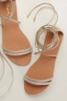 Channel your inner Athena in these gilded braided sandals that lace up the ankle.  By Qupid  Synthetic leather upper, synthetic sole  Fits true to size  Crafted in China