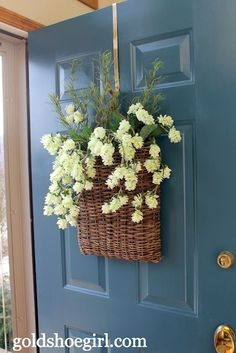 Front door wreath alternative - flat basket with seasonal faux flowers or line with plastic, insert wet floral foam & use real flowers!
