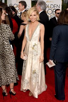 The 2015 Golden Globe Awards: Sienna Miller, in Miu Miu, with a Christian Louboutin clutch and Jimmy Choo shoes