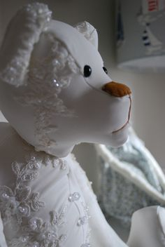 Wedding dress Keepsake Bear www.bowmanbears.com Keepsake bear made from a much loved wedding dress. Pillows and hearts can also be made from a wedding dress too.