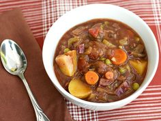 A Hearty Vegetable Stew chock full of healthy starches, veggies, mushrooms, and a rich savory broth. Paired with a thick slice of homemade bread - perfect.