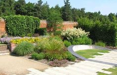 marks hall - grass in/out of pavers/circular 3-D orb cutting across and up