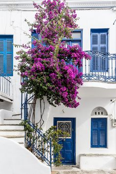 House with blue doors and shutters on the island of Tinos in Greece #house #tinos #cyclades #greece