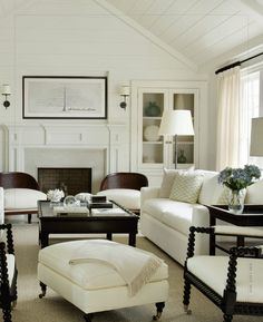 LOVE the chairs in the foreground with the round balls on the arms. white livingroom