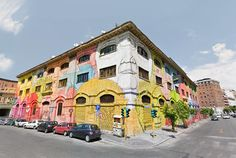 Italian street artist Blu transforms a former military warehouse in Rome with over 25 colourful faces