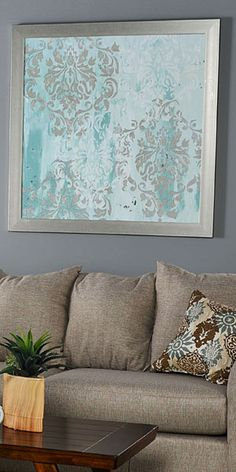 This unique print features a vintage inspired silver and turquoise pattern. Shop online now. #LivingSpaces