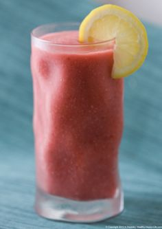 Strawberry Frosted Pink Lemonade (2 cups lemonade   1 1/2 cups frozen strawberries  1 large frozen banana    1 cup ice cubes   2 Tbsp fresh lemon juice  lemon slices and/or mint leaves for garnish)