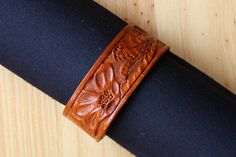 Hand Carved Floral Leather Bracelet by Tina's Leather Crafts on Etsy.com.  Repin To Remember.