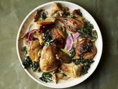 Pan-Seared Chicken with Riesling Cream Sauce, Chanterelles, and Chard. Pan-roasting—as opposed to slow-braising—renders the chicken skin golden and the meat tender and juicy for this dish. via saveur Turkey Recipes, Meat Recipes, Chicken Recipes, Cooking Recipes, Saveur Recipes, Fancy Recipes, Dinner Recipes, Poulet Au Riesling, Chard Recipes