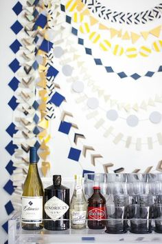 Try dressing your bar area up with homemade paper garlands when hosting a party, like Lonny's own Cat Dash did for her friend's co-ed baby shower.