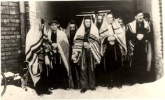 Zawiercie, Poland, Abuse, Jews in the snow with prayer shawls draped on them.