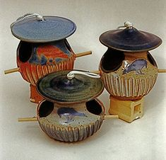 Google Image Result for http://www.annspottery.com/pottery/images/other-bird-feeders-lg.jpg