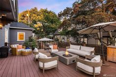 Large deck that takes up much of the backyard and leads to lower patio. the deck is strictly for lounging with 3 large armchairs and a long sofa as well as Deck Seating, Deck Lounge Ideas, Deck Tv Ideas, Garden Seating, Free Deck Plans, Small Dining Table Set, Island Deck, Modern Deck, Floating Deck