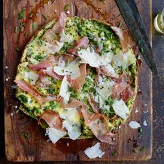 This sensational 15-minute frittata is creamy and delicate like scrambled eggs. It's finished with an array of toppings, including prosciutto and cheese.