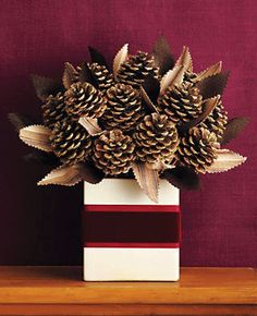 """Gift"" centerpieces using tissue boxes and pinecones"