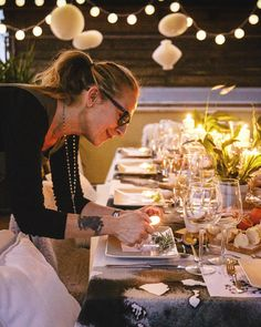 Elisabetta adds the finishing touches to her table setting