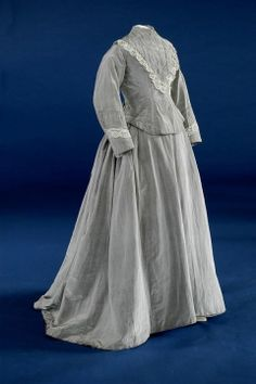 Wedding Dress  Two piece grey alpaca wedding dress with full skirt at back.    Place: England    Object Type: wedding dress    Period: Victoria    Broad Date: Late Victorian    Actual Date: 1878    Century: 19th century    Material: Alpaca Wool    Museum Accession Number: 1970.172/CST.1658