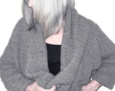 A very easy designer hand knitting pattern. Suitable for the new to knitting, or the experienced knitter who would like a very easy project. Knit in garter stitch (knit every row)  The knitting pattern is written for one size: To fit sizes 86cm 34in to 117cm 46in chest. This fabulous On Trend Hooded Wrap Cardigan is really versatile with lots of comfortable ease in the body to flatter all sizes. Perfect for those long, cold winter nights, cuddly, warm and comfy. Wear as a fashion statement…