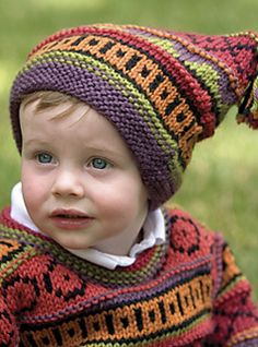 Pattern is for a brightly patterned stranded (fair-isle) sweater and matching jester-style hat with tassels.