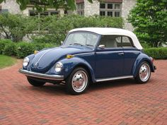 1971 Blue VW Super Beetle Convertible with white top. My second car. My favorite of all cars I've owned. Wish I had it now.