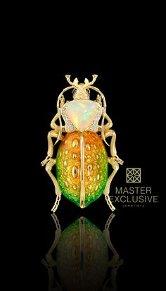 """Brooch """"Жук-Карабус"""" 12916 Collection: World of insects  18K yellow gold, opal 1,43 ct, diamonds, black diamonds, enamel."""
