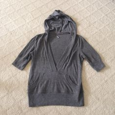 Soft Dark Gray Forever 21 Deep V Hoodie Soft dark gray pre-owned Forever 21 deep v hoodie with ribbed detail and front pocket pouch. 61% Polyester, 33% Rayon, 6% Spandex. Made in the USA. Forever 21 Tops Sweatshirts & Hoodies