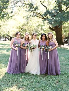 Bridesmaids in Purple Gowns | Brides.com