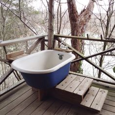 Ever dreamed of a bathtub on your front porch? And how about overlooking a river?