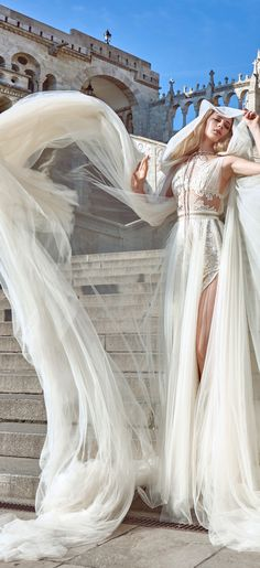 Flavia gown and its cape. Designed with impressive and rich in fabric, this wedding cape with it's hood is certain to make every wedding ceremony a memorable one.