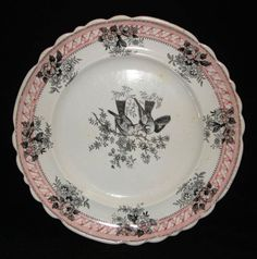 "www.transcollectorsclub.org Here is a ""Cornelian"" pattern plate printed in pink and black, ca. 1835. ""Cornelian"" may refer to the cornelian cherry dogwood which has vaguely similar leaves and flowers. Or, perhaps ""Cornelian"" is the name of the birds? Some help would be appreciated."