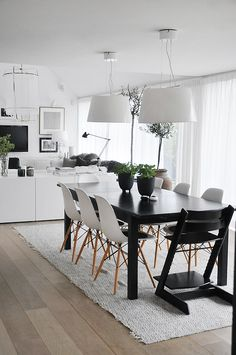 my scandinavian home: Swedish ceramicist's living space Love the bookcase separating living and dining room design room design decorating Dining Room Design, Dining Area, Eames Dining, Dining Rooms, Eames Chairs, Dining Tables, Wooden Chairs, Rug Under Dining Table, Design Kitchen