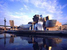 Guggenheim Museum, Bilbao, by Gehry. 1997.  Deconstructivism. Sculptural qualities. Titanium shingles.