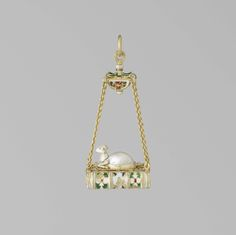 Earring, part of a pair of gold, enamel and baroque pearl, depicting a hanging book on which a lamb (Lamb of God on the book of the seven seals).Europe, ca. 1580 .