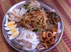 variety of Laotian food. Papaya salad. Yummy!