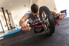 The ab wheel is both a simple and complex exercise device. At first glance, it's just a wheel with a handle through it and grips on both sides. Using it may also appear simple, as you watch exercisers roll the wheel forward and backward. Those movements can be so complicated, however, that only well-conditioned experts can perform some ab wheel...