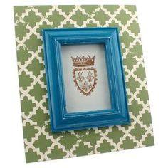 "Picture frame with quatrefoil motif.Product: Picture frameConstruction Material: MDF and glassColor: White, blue and greenFeatures: Quatrefoil designHolds standard 5"" x 7"" photoDimensions: 12 H x 9.8 W x 1.3 D"