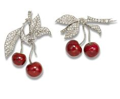 A pair of diamond and enamel 'cherry' brooches The 19th-century brooches realistically modelled as a cherry bough set with cushion, old brilliant and rose-cut diamonds suspending two later enamelled cherries, diamonds approximately 11.70 carats total.