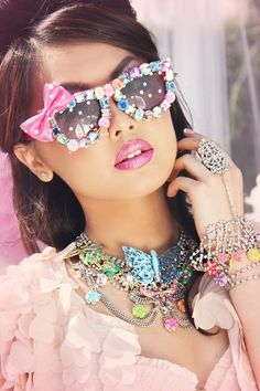 Our KAWAII stunners are fun and colorful. These sunglasses add the perfect splash of color to any outfit!! Can you say HELLO KITTY?? Adorned with assorted pom poms, premium gems, see thru lace and a s