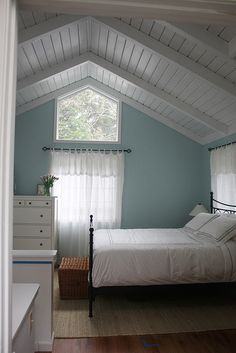guest bedroom: just simpicity: blue walls, sheer white curtains, would have some neutral but homey bedding, and probably darker furnishings