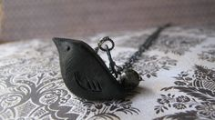 The Following Necklace, Edgar Allen Poe Necklace, The Raven, Nevermore, Spooky, Goth, Bird Jewelry, Blackbird Pendant. $25.00, via Etsy.