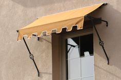 Traditional Fabric Awnings with wrought iron spears. They should have added a decorative plate at the base of the spear and a pointed spear through the awning. Front Door Awning, Window Awnings, Architecture Details, Interior Architecture, Aluminum Awnings, Caravan Awnings, Fabric Awning, Retractable Awning, Door Canopy