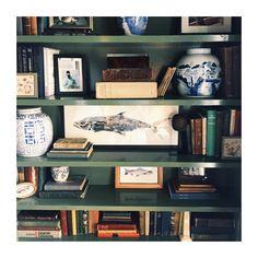 Shelves styled with art, books, blue & white - Jessie Epley Short