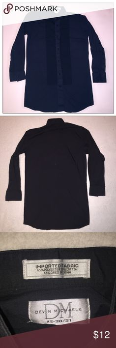 """Black Ruffle Button Down Dress Shirt Black men's ruffle button down dress shirt. Extra small, size 30-31. Lightly used, still in excellent condition. Made of 65% polyester, 35% cotton.     Measurements (approx..)  Sleeve:21.5""""  Shoulder Width: 17""""  Chest: 20""""  Length: 31.75"""" Shirts Dress Shirts"""