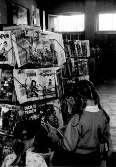 Comics...always thought of as a boy's only hobby.  Here is a girl from the fifties or late forties at the comic rack.  Awesome!