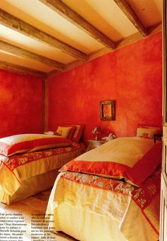 Rustic Style bedroom in Provence France with distressed Persimmon Orange walls and Maise Yellow bedding