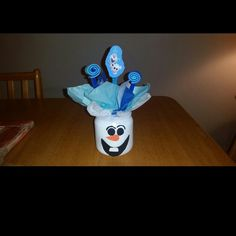 Olaf Frozen Birthday centerpiece decoration New handmade item  inspired by Frozen movie  measures aproximately Materials: crystal jar, crepe papers, foam unique Other
