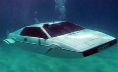 Always dreamed of driving a Bond-worthy whip? Well hopefully you've been saving up, because in early September they're auctioning off the Lotus Esprit Submarine Roger Moore drove off the pier (and underwater) in The Spy Who Loved Me. Lotus Esprit, James Bond Cars, James Bond Movies, Film Cars, Movie Cars, Shaquille O'neal, Spy Who Loved Me, Aston Martin Db5, Lotus Car